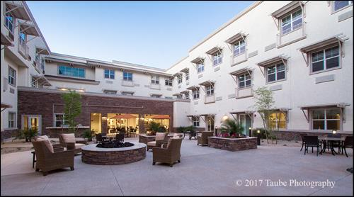 Our inviting courtyard has a fire pit, fireplace, putting green and cozy seating.