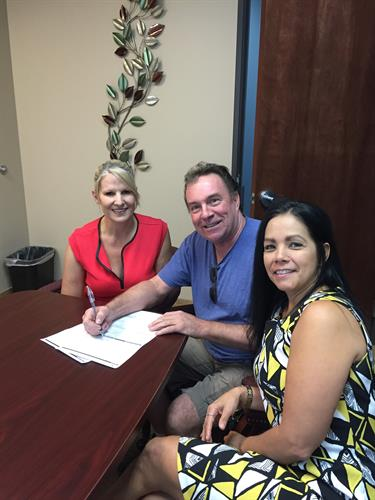 Signing at the sale of his home and purchase of his new home!
