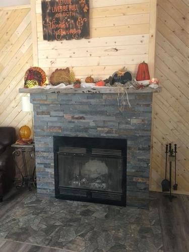 new fireplace, added stone and wood finish