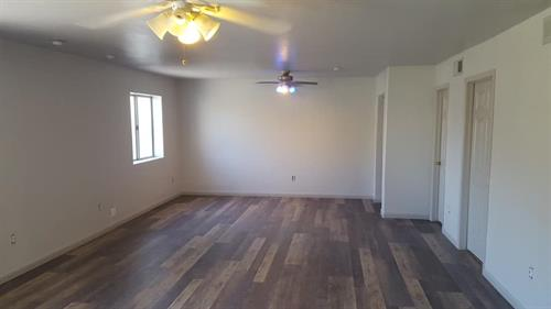 finished room, removed fireplace added new flooring and paint