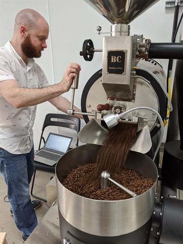 Zach at work roasting single-origin specialty coffee.