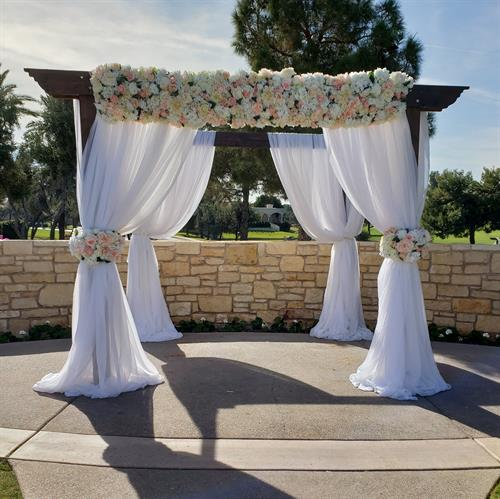 Chuppah with peach silk floral rentals