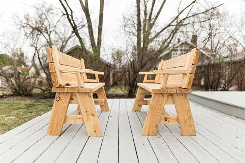 Convertible outdoor picnic table converts from two individual benches to a table.