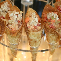 Cashew chicken in a wonton bouquet cup