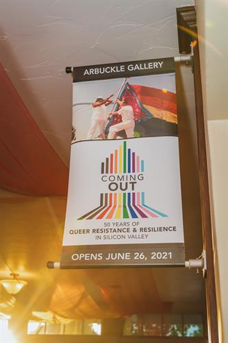 A banner of Coming Out at History Park