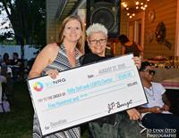With Gabrielle (DeFrank Center President) with the SVNRG donation at the RCC annual BBQ