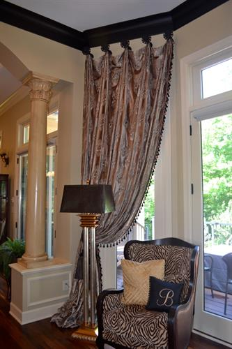 Beautiful vignettes happen when custom draperies are added to a home!