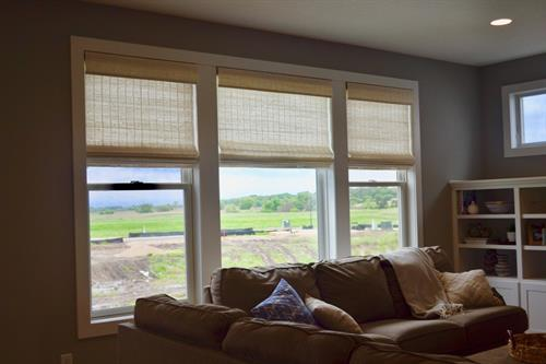 Beachy Airy Roman Shades help to enhance privacy and complete these windows in Woodbury