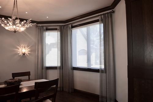 Soft sheers complement this dining area.