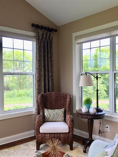 Relaxing in the Sun Porch is great with custom side panels to complete the room