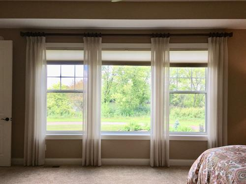 Pretty sheers helped to soften and complete this master bedroom.