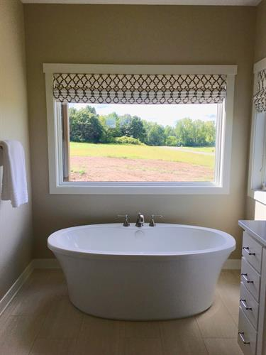 The Roman Shades above the master bath help to finish off this otherwise stark corner, and provide total privacy.