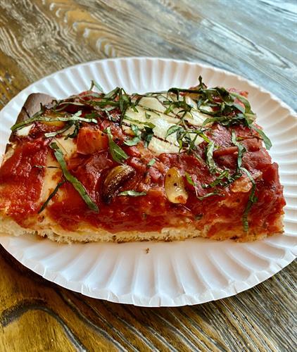 Our new focaccia style Sicilian slice.