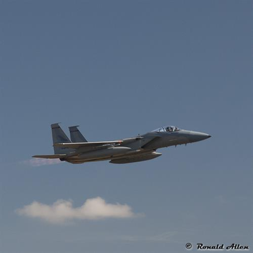 An Air Force F-15 Eagle soaring by