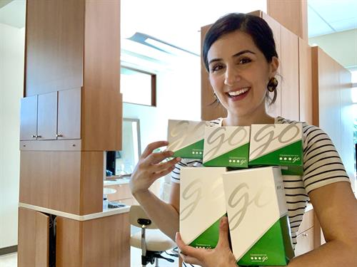 Dr. Carmody ready to gift Take-home whitening kits to her New Patients