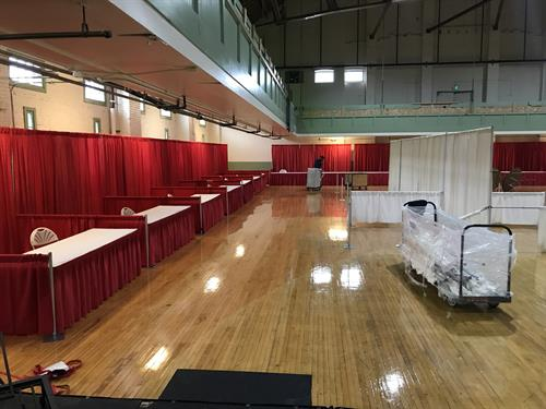 Tradeshow Event: Staging, flooring, tables/chairs, linens, lighting, draping, red carpets and more