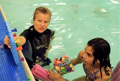 Aquatic therapy helps children develop strength and coordination in a safe and supportive environment.