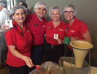 We Serve!  Helped prepare meals for Stop Hunger project!