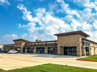 The J. Beard Real Estate Company represents Harmony Commons Shopping Center in a lease with Oral Surgery Management, Inc.