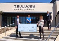 Truluck's donates $600 to Children's Safe Harbor