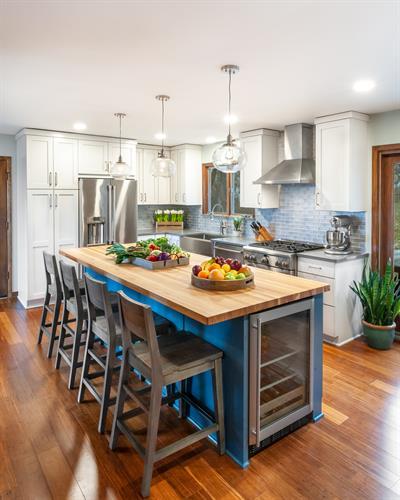 Bright Blue Kitchen with Butcherblock countertop island