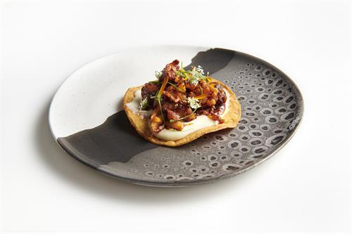 Smoked lobster tostada with lime aioli, salsa mocha, and cilantro.