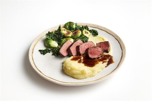 Perfectly-cooked NY strip over creamy, whipped potatoes with roasted Brussels sprouts and kale... topped with a silky cabernet demi.