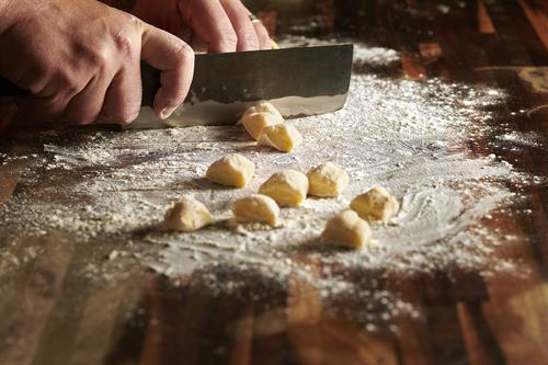 Our food is all prepared from scratch! Here, Chef Mitch is preparing his own gnocchi dough.