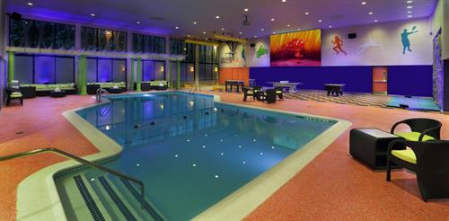 Indoor Pool & Sports Deck: available for pool parties, includes games, climbing wall and free throw basketball lane.