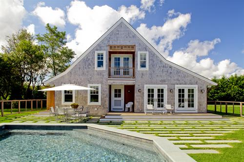 Small swimming pool and pavers in grass at a private residence