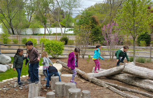 A school field trip visits a natural play area at MassAudubon's Broadmoor Wildlife Sanctuary in Natick