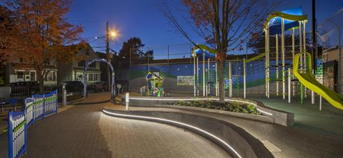Cremin Playground in Somerville has custom lighting in the seat walls and play equipment