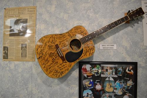 Autographed guitar of Hall of Fame Inductees.