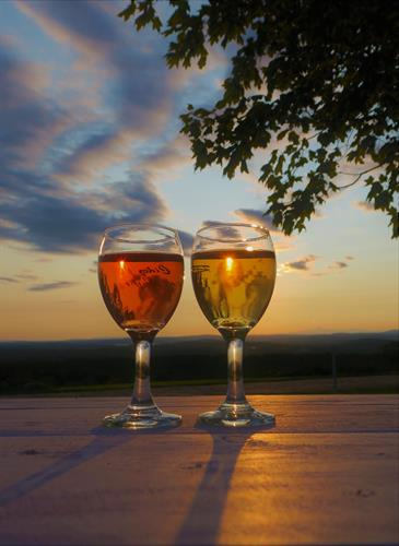 Sip our Mainiac Hard Cider while viewing the sunset