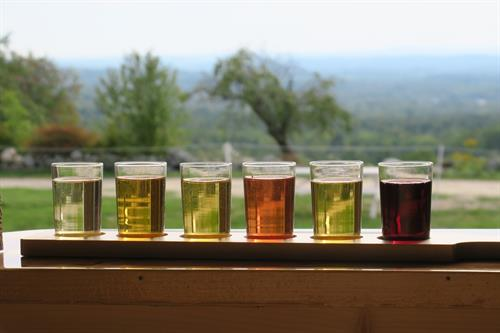 Sip cider while drinking in the view from our tasting room bar in the big red barn.