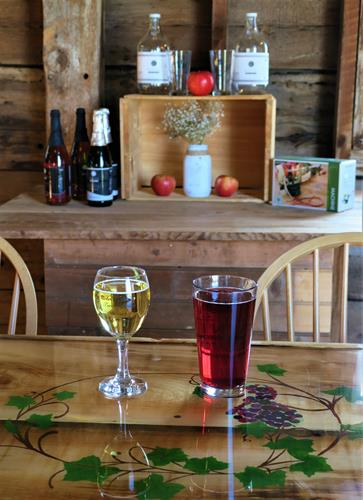 Sip Mainiac Hard Cider & Ricker Hill Wine at our custom made bar in the 1833 red barn.
