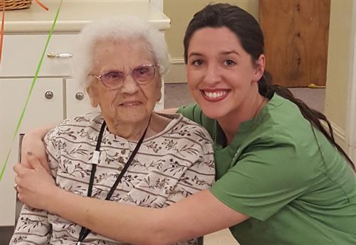 Beacon Hospice employee Kayla celebrating Cecile's 105th birthday