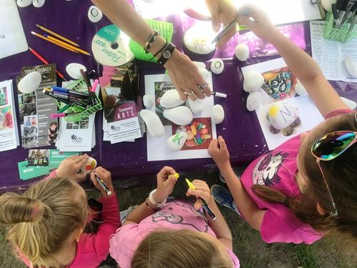 Children creating painted rocks at the Newport Farmer's Market