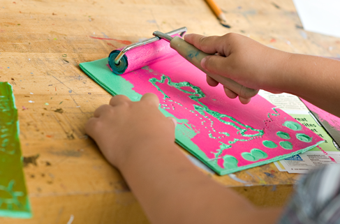 A student practices print-making in the Arts Center Studio