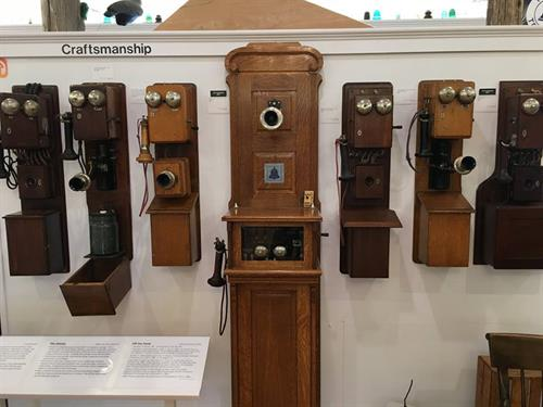 From the early wall-mounted telephones with their beautiful craftsmanship...