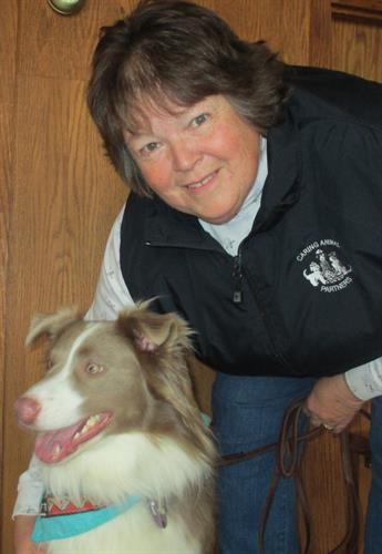 Flip, a Therapy dog, who visits with his owner, Dee.
