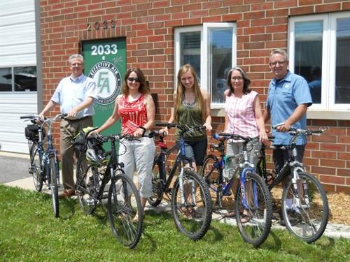 We love to bike, here is our office staff  who all rode there bikes to work