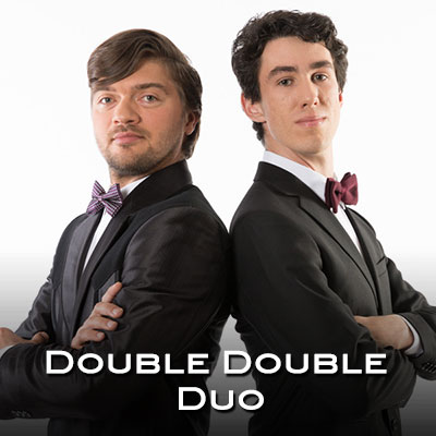 """Join us Thursday, March 26, 2020 at Dickinson State University. Each of these musicians is a """"double threat,"""" playing two instruments apiece (piano is each man's second). Polish Kornel Wolak and Canadian Michael Bridge are classically trained but use comedy along with their virtuosity to bring their classical repertoire to life."""