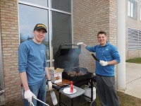 Student Senate representatives cooking burgers during Welcome Back Week