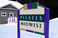 Pilates Midwest's new location!  Look for the purple door!