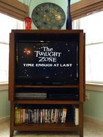 Flat Screen TV w/ 60s DVD Library