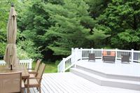 Spacious yard with tiered deck
