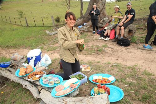 Lunch served with a smile on the trail. Our philosophy with food - fresh, healthy, abundant