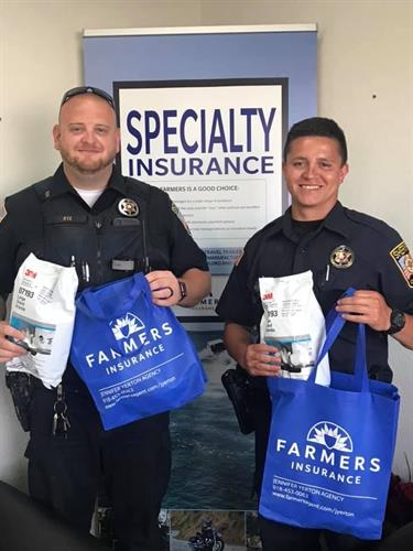 Donation day to Cherokee County Sheriff's officers from Jennifer Yerton at Farmers Insurance Agency