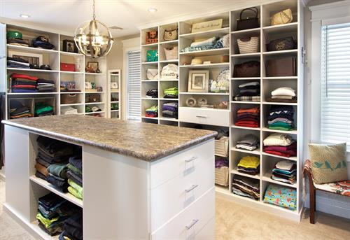 A sophisticated master closet with maximum functionality